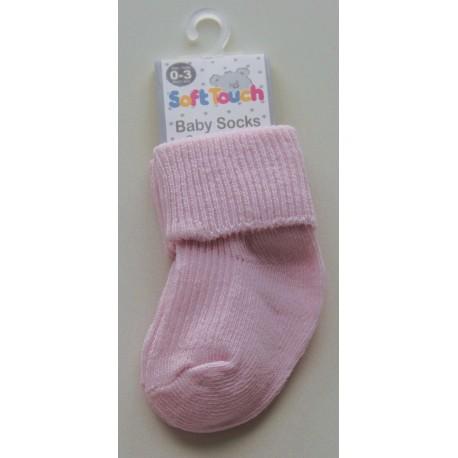 Roze sokjes voor pasgeboren